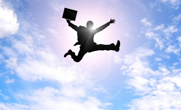 ジャンプする絶好調のサラリーマン男性